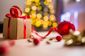 brown christmas present with red ribbon free stock photo