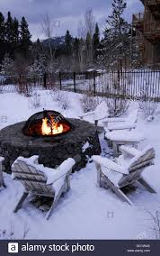 California Fire Pit by Fire Pit And Adirondack Chairs In Snow In Lake Tahoe California