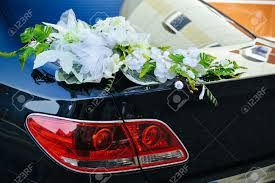 romantic wedding decoration flower on wedding car in and