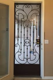wrought iron security screen doors with scrolls and knuckles