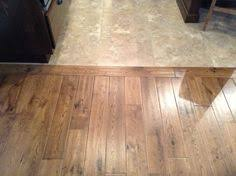 light tile with a seamless transition to wood floor