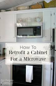 how to trim the bottom of a cabinet how to retrofit a cabinet for a microwave an oregon cottage