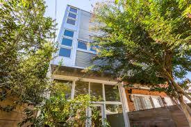 row home design news on the market sunny modern row house in burleith offers flexible
