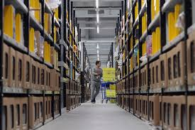 prepareing your amazon products for black friday inside the amazon warehouse where staff rush to fulfil black