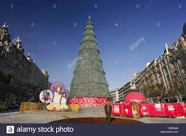 an artificial christmas tree is put up at a square in the city