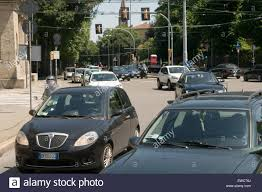 driving italy italy road roads busy fast car cars in junction