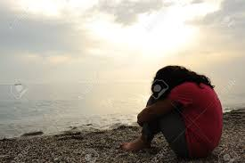 images of sad girl lonely sad girl on the dark beach stock photo picture and royalty