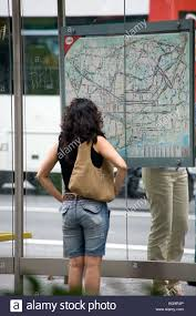 Map Of Barcelona A Lost Tourist Looks At A Bus Stop Map Of The City Of Barcelona