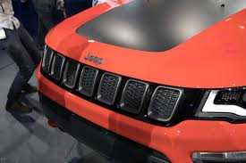 orange jeep lifted 6 different ways you can configure the 2017 jeep compass motor trend