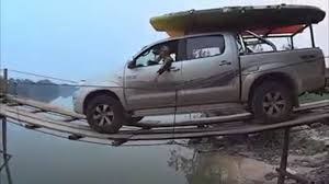 Insane Driver Goes Over A Thin Wooden Bridge With A Toyota Truck
