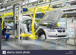 bmw factory robots an employee of car manufacturer bmw works on a car at the bmw