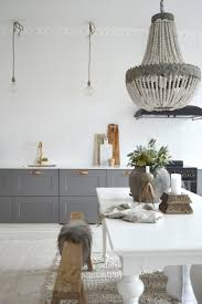 i m so happy as i ve just found myself a little spot outside of my scandinavian home grey and white kitchen in the serene home of swedish interior stylist denice lindell