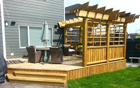 Deck With Pergola by Treated Deck With Custom Privacy Screen And Pergola Craftsman