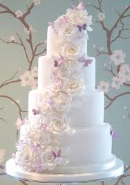 butterfly wedding cake the louise cake with white sugar roses and lilac butterflies by