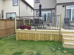 decor green grass with wrought iron railing also wooden siding