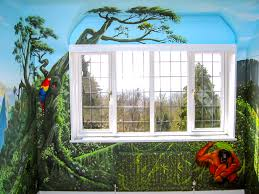 the jungle painted wall opposite the dorway with parrot and shy this beautifully painted jungle mural made a young lady very happy and features some great details get superb jungle murals painted for your kids here