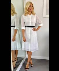 holly willoughby wears a white cefinn shirt dress on this morning