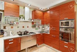 kitchen interior with wooden furniture and many utensils in warm kitchen interior with wooden furniture and many utensils in warm tones on wide angle view stock