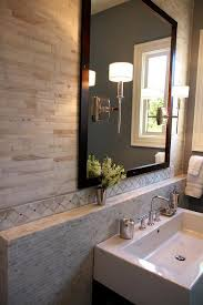 sconces mounted on bathroom mirror design ideas
