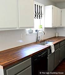 light grey kitchen cabinets with wood countertops two tone kitchen cabinets to inspire your next redesign