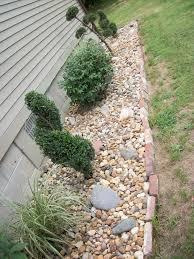 rock garden with topiaries low maintenance easy gardening