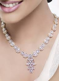 a new collection of diamond and kundan jewellery is launched at