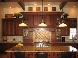 decor over kitchen cabinets decor for above kitchen cabinets above