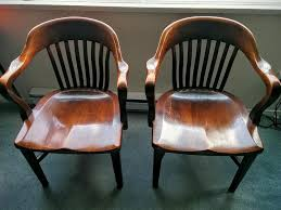 pair of solid oak bankers chairs reduced victoria city victoria
