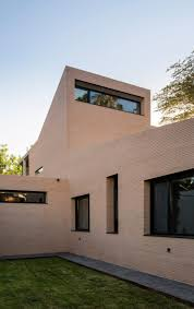 col house concrete portico provides shelter at pink brick house in seville