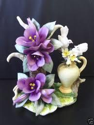 capodimonte itialian porcelain purple flower figurine with two
