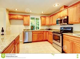 Bright Kitchen Cabinets Bright Kitchen Room With Light Brown Cabinets And Steel Appliances