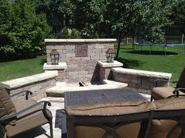 Unilock Patio Designs by Unilock Fire Pit And Wall With Patio Garden Pinterest Patios