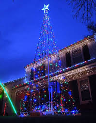 images behind the scenes with a suburban christmas light fanatic
