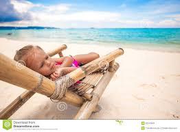 Chairs On A Beach Baby Sitting On A Beach Chair Stock Photos Image 32313423