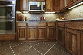 Cleaning Wood Cabinets Kitchen by Kitchen Floor Kitchen Floor Installing Hardwood Flooring Diy Floor