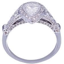 18k white gold pear shape diamond bezel set engagement ring art