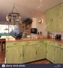 pastel green fitted cupboards with dragging paint effect in