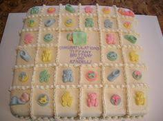 yellow sheet cake with butter cream frosting accents are fondant