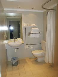 bathroom shelving ideas over toilet curved brown varnsihes