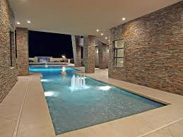 contemporary swimming pool with exterior tile floors u0026 indoor pool