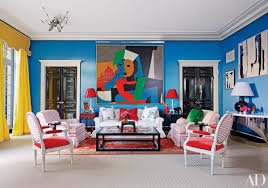 how to make traditional decor feel fresh this colorful and eclectic home boasts bright blue walls yellow curtains contemporary artworks