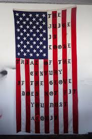 American Flag In Text The Artist Behind Kanye U0027s Iconic Tour Merch On His New Exhibition