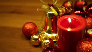 Red And White Christmas Lights Christmas Candles Flicker Alongside Christmas Bells And Greenery