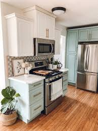 diy repaint kitchen cabinets how to diy painted kitchen cabinet tutorial the revival