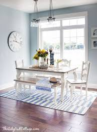 light blue dining rooms inspiration for a beach style dark wood