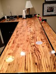 bar made out of oak hardwood flooring i torched the wood before