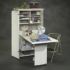 diy craft armoire with fold out table how to create a diy craft armoire home storage unit tips for