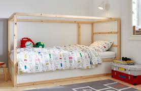 big world small scale children s bedroom with white walls and single bed in pine and white