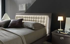 bedroom master bedroom with white modern bed and green tufted