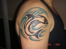 ocean waves and tribal shark tattoos on shoulder photo 2 real